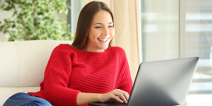 Woman using the Internet on her laptop