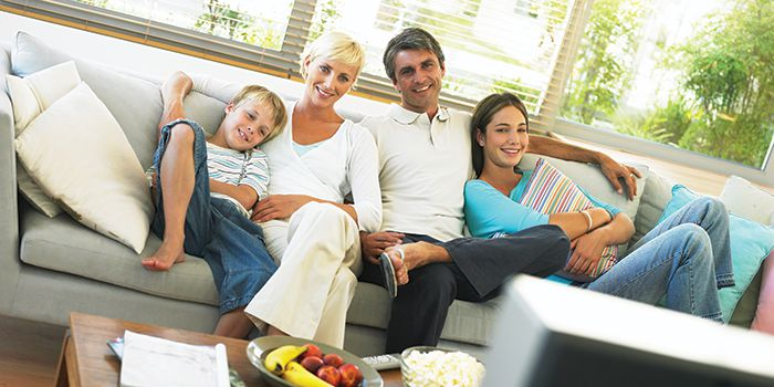 Family watching TV on the couch